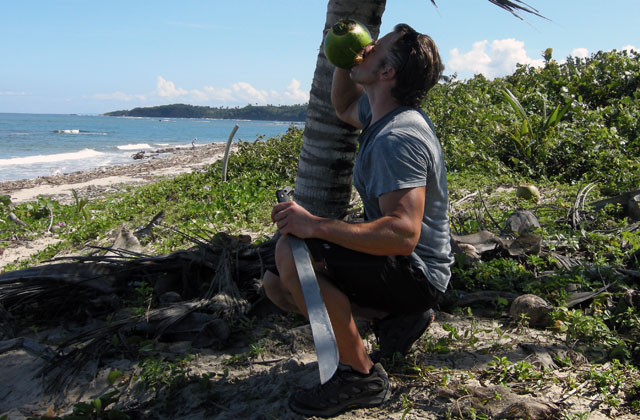 Getting-Into-A-Coconut-With-A-Machete-In-The-DR