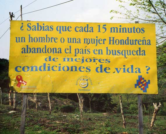"Road sign. ""Did you know that every 15 minutes a Honduran man or woman leaves the country in search of better living conditions?"" I can't really blame them."